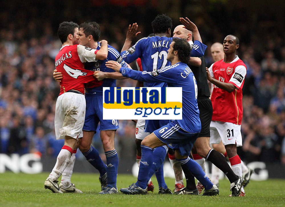 Photo: Rich Eaton.<br /> <br /> Chelsea v Arsenal. Carling Cup Final. 25/02/2007. Cesc Fabregas left of Arsenal and Frank Lampard centre of Chelsea wrestle as Ricardo Carvalho tries to pull them apart