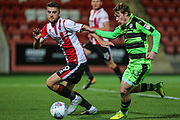 Forest Green Rovers Luke James(33) and Cheltenham Town's Alex Davey(29) during the EFL Trophy match between Cheltenham Town and Forest Green Rovers at Whaddon Road, Cheltenham, England on 3 October 2017. Photo by Shane Healey.