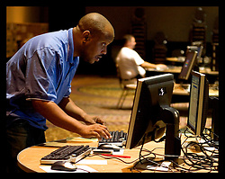 10th Sept, 2005. Deep in the heart of the Hyatt Hotel in downtown New Orleans the O.E.M. (Office of Emergency Management) takes shape. Contractors for Unisys start to rebuild the communications, command and control computer networks and infrastructure that is vital to the rebuilding of New Orleans following the devastation of Hurricane Katrina. Technician Brandon Haynes, working for the City of New Orleans under contract  sets up 100 computers ready for teams to get back to restoring functioning government.