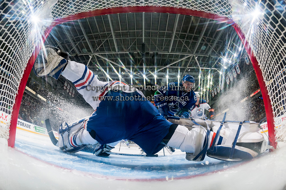 PENTICTON, CANADA - SEPTEMBER 11: Stuart Skinner #50 of Edmonton Oilers makes a save on a shot by Jakob Stukel #34 of Vancouver Canucks on September 11, 2017 at the South Okanagan Event Centre in Penticton, British Columbia, Canada.  (Photo by Marissa Baecker/Shoot the Breeze)  *** Local Caption ***