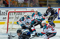 KELOWNA, CANADA - DECEMBER 30: Braydyn Chizen #22 keeps his eye on the puck ahead of Roman Basran #30 of the Kelowna Rockets against the Victoria Royals on December 30, 2017 at Prospera Place in Kelowna, British Columbia, Canada.  (Photo by Marissa Baecker/Shoot the Breeze)  *** Local Caption ***
