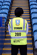 A Match steward guards the stands before the EFL Sky Bet Championship match between Sheffield Wednesday and Bristol City at Hillsborough, Sheffield, England on 22 April 2019.