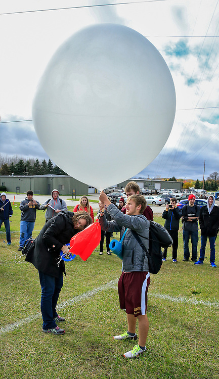 Weather Balloon Launch. MET 260 Intro to Atmospheric Science students of Daria Kluver, Asst. Professor of Climatology, release a weather ballon south of the athletic complex. They monitor the path and other data which is transmitted to their laptop. Photo by Steve Jessmore/Central Michigan University