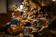 A traditional carved wood statue sits in the entrance of Sumo Japanese Steakhouse & Sushi Bar in Madison, Wisconsin, Wednesday, March 21, 2018.