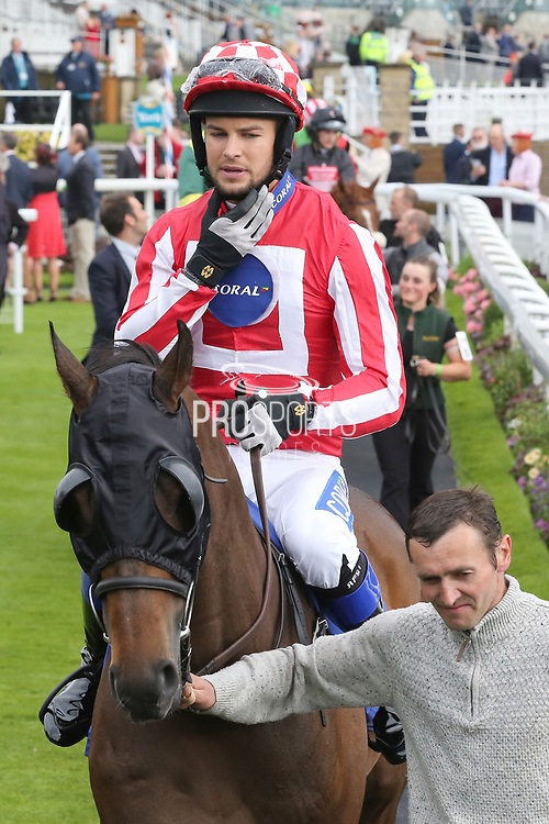 Love Island Celebrity CHRIS HUGHES riding Carnageo trained by Richard Fahey and taking part in the The Best Western Hotels & Macmillan Ride of their Lives Charity Race over 1m 1f during the Macmillan Charity Raceday at York Racecourse, York, United Kingdom on 16 June 2018. Picture by Mick Atkins.