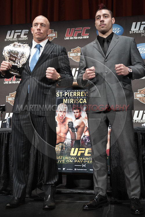 "NEW YORK, NEW YORK, MARCH 24, 2010: UFC welterweight champion Georges St. Pierre (left) and challenger Dan Hardy pose for photographs during the pre-fight press conference for ""UFC 111: St. Pierre vs. Hardy"" inside Radio City Music Hall in New York City"