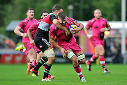 James Down of London Welsh is tackled bt Nick Easter - Photo mandatory by-line: Patrick Khachfe/JMP - Mobile: 07966 386802 04/10/2014 - SPORT - RUGBY UNION - London - The Twickenham Stoop - Harlequins v London Welsh - Aviva Premiership