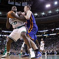 04 March 2012: New York Knicks small forward Steve Novak (16) defends on Boston Celtics power forward Brandon Bass (30) during the Boston Celtics 115-111 (OT) victory over the New York Knicks at the TD Garden, Boston, Massachusetts, USA.