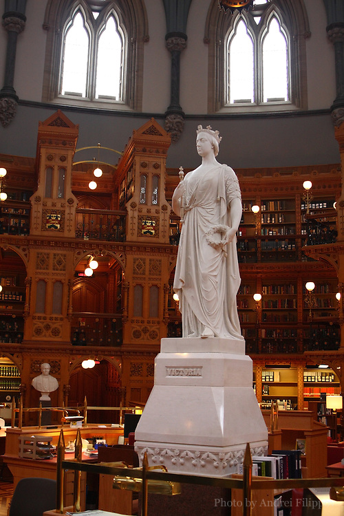 Interiors of the Parliamentary Library of Canada in Ottawa, Ontario, Canada on February 22, 2009. The statue of Queen Victoria placed in the center of the library main room.
