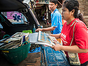 14 SEPTEMBER 2015 - BANGKOK, THAILAND:  People pack a pickup truck with the belongings from the home they're being evicted from. Fiftyfour homes around Wat Kalayanamit, a historic Buddhist temple on the Chao Phraya River in the Thonburi section of Bangkok are being razed and the residents evicted to make way for new development at the temple. The abbot of the temple said he was evicting the residents, who have lived on the temple grounds for generations, because their homes are unsafe and because he wants to improve the temple grounds. The evictions are a part of a Bangkok trend, especially along the Chao Phraya River and BTS light rail lines. Low income people are being evicted from their long time homes to make way for urban renewal.           PHOTO BY JACK KURTZ