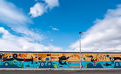 Pictured: Edinburgh Dog & Cat Home Mural Unveiling. , Edinburgh, Scotland, 03 May 2019. The 80 foot mural is unveiled today as a colourful addition to Seafield promenade. It is designed and painted by local artists Studio N_Name. It depicts the people, heritage and environment of the local community and features flora, fauna and historic elements of the local coastline. It has been made possible through through partnership with Edinburgh Shoreline Project. It is on the seafront wall of the dog & cat home which rescues, reunites and rehomes lost, stray and abandoned dogs and cats across Edinburgh and the Lothians, caring for 2,367 dogs and 771 cats in 2018.<br /> Sally Anderson | EdinburghElitemedia.co.uk