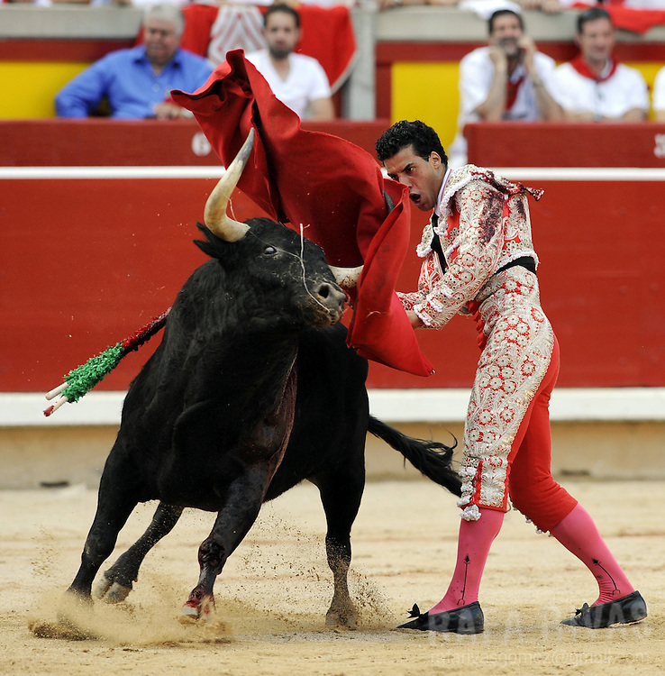 Spanish matador Morenito de Aranda performs a pass to a Cebada Gago bull, during the third corrida of the San Fermin Festival, on July 9, 2012,  in the Northern Spanish city of Pamplona. PHOTO / Rafa Rivas
