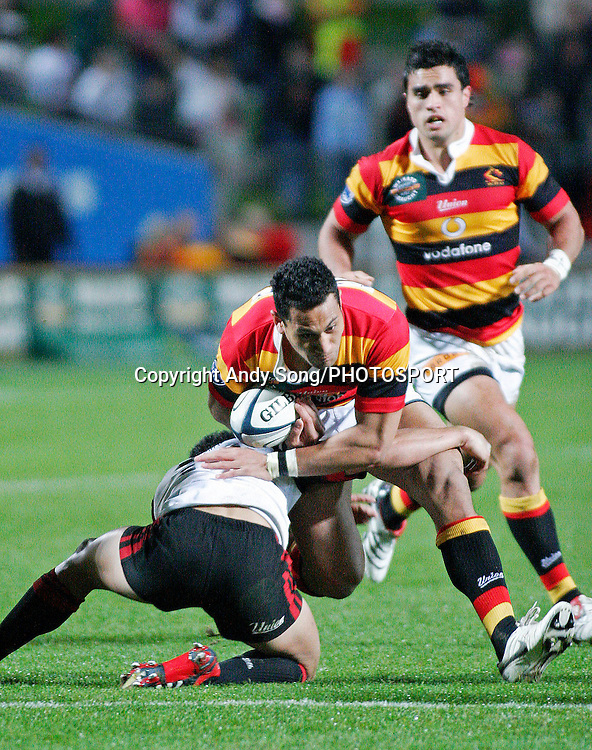 Waikato back Roy Kinikinilau (centre) gets tackled during the Air New Zealand Cup week 3 rugby union match between Waikato and Canterbury at Waikato Stadium in Hamilton, New Zealand on Friday 11 August 2006. Photo: Andy Song/PHOTOSPORT