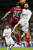 Real Madrid´s Nacho and Real Sociedad´s Elustondo during La Liga match between Real Madrid and Real Sociedad at Santiago Bernabeu stadium in Madrid, Spain. December 30, 2015. (ALTERPHOTOS/Victor Blanco)