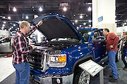 Randy Oleson and son Dustin look over the GMC truck