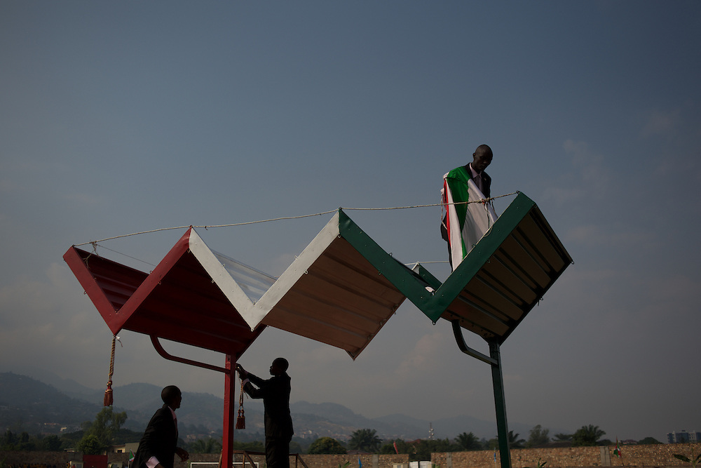 Staff members, at Prince Rwagasore Stadium in Bujumbura, work on the last touches to a podium to be used by president Pierre Nkurunziza during celebrations of Burundi's 53rd Independence Anniversary.