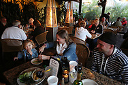 BRENDAN FITTERER  |  VISIT FLORIDA<br /> Madison Hoffmann, 20 months, left, dines with her parents Nessa and Larry Hoffmann, of Long Island, NY, at Mattison's City Grille downtown Sarasota, 1 North Lemon Ave Sarasota, FL 34236.