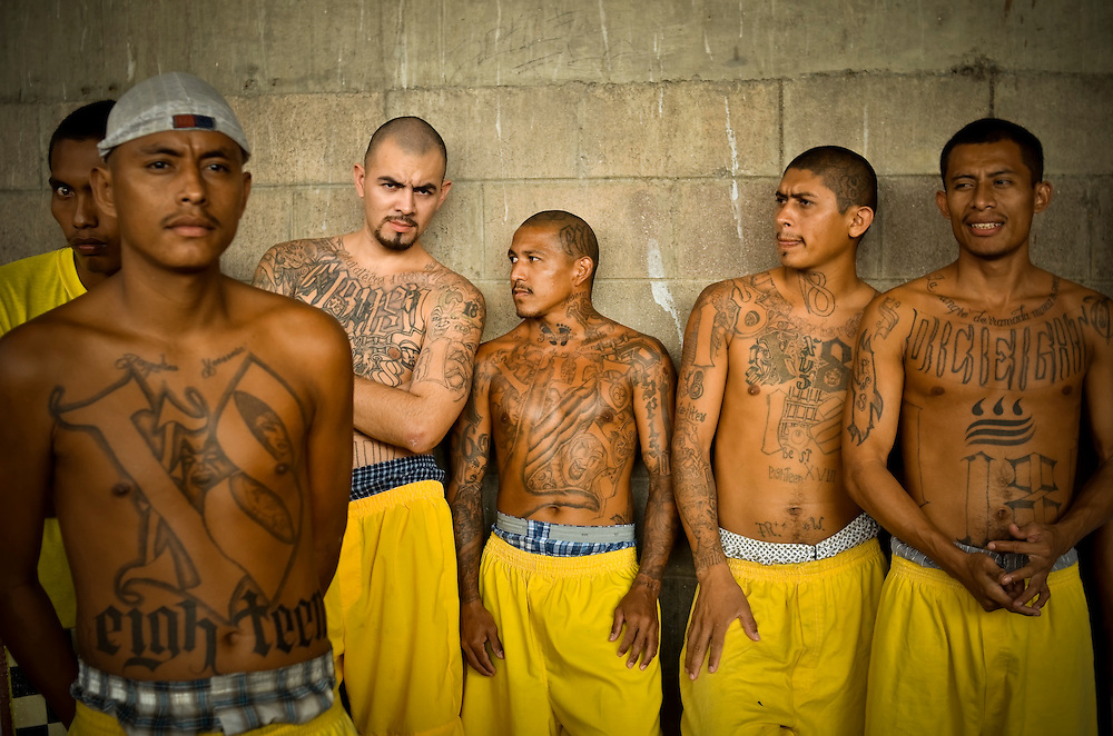Members of the Mara 18 gang incarcerated in Izalco men's prison in El Salvador pass the afternoon in the prison yard.