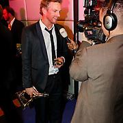NLD/Utrecht/20101001 - NFF 2010 - Gouden Kalveren 2010 uitreiking, Barry Atsma met zijn gewonnen Gouden Kalf en gouden penis in zijn hand