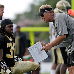 04 August 2009: Saints defensive coordinator Gregg Williams talks with defensive backs Danny Gorrer (38) and Reggie Jones (35) during New Orleans Saints training camp at the team's practice facility in Metairie, Louisiana.