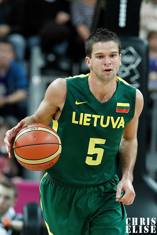 02 August 2012: Lithuania Mantas Kalnietis brings the ball upcourt during 82-74 Team France victory over Team Lithuania, during the men's basketball preliminary, at the Basketball Arena, in London, Great Britain.