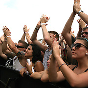 Crowds of fans clap at the Rockstar Energy Drink Festival at the 1-800-Ask-Gary amphitheater in Tampa, Florida on Thursday, September 13, 2012. (AP Photo/Alex Menendez)