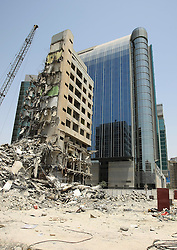 Abu Dhabi Construction.<br /> An old block of flats is demolished to make way for new modern buildings in Hamden Street, Abu Dhabi, United Arab Emirates, <br /> 21st July 2008. <br /> Picture by Andrew Parsons / i-Images