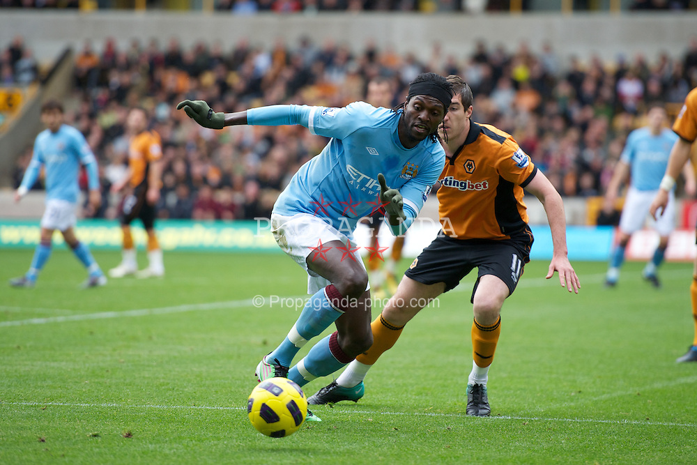 WOLVERHAMPTON, ENGLAND - Saturday, October 30, 2010: Manchester City's Emmanuel Adebayor and Wolverhampton Wanderers' Stephen Ward during the Premiership match at Molineux. (Pic by: David Rawcliffe/Propaganda)