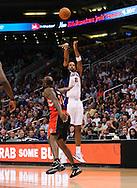 Mar. 23, 2011; Phoenix, AZ, USA; Phoenix Suns forward Channing Frye (8) puts up a basket against the Toronto Raptors forward Reggie Evans (30) at the US Airways Center. The Suns defeated the Raptors 114-106. Mandatory Credit: Jennifer Stewart-US PRESSWIRE..