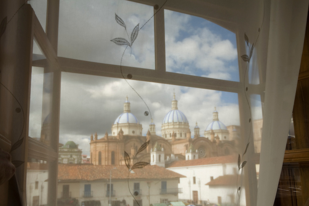 Cathedral of Immaculate Conception, built 1885, viewed through curtains of hotel room.  Cuenca, Ecuador, South America.  Cuenca is a UNESCO World Heritage Site.