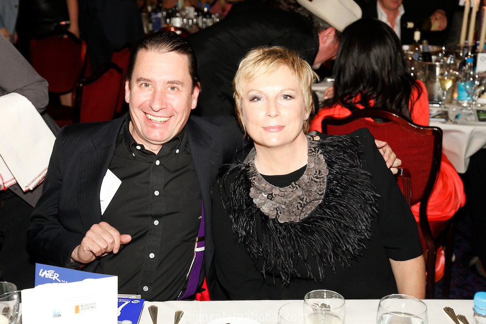 Jools Holland and Jennifer Saunders, the 2011 MITs Award. Held at the Grosvenor Hotel London in aid of Nordoff Robbins and the BRIT School. Monday, Nov.7, 2011