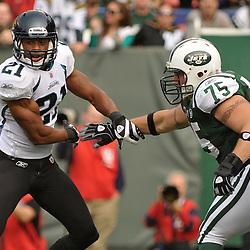 Nov 15, 2009; East Rutherford, NJ, USA; New York Jets offensive tackle Robert Turner (75) blocks Jacksonville Jaguars cornerback Derek Cox (21) during first half NFL action between the New York Jets and Jacksonville Jaguars at Giants Stadium.
