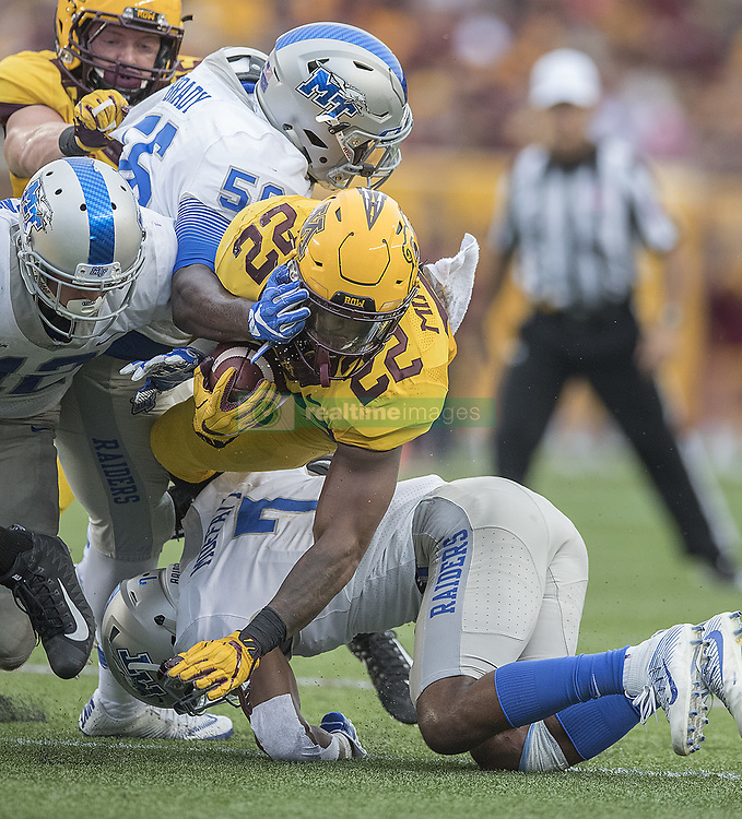 September 16, 2017 - Minneapolis, MN, USA - Minnesota running back Kobe McCrary (22) is brought down by Middle Tennessee safety Jovante Moffatt during the third quarter at TCF Bank Stadium, Saturday, Sept. 16, 2017, in Minneapolis. The host Gophers won, 34-3. (Credit Image: © Elizabeth Flores/TNS via ZUMA Wire)