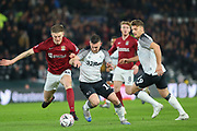 Derby County forward Jack Marroitt (14) is challenged by Northampton Town defender Scott Wharton during the The FA Cup match between Derby County and Northampton Town at the Pride Park, Derby, England on 4 February 2020.