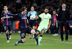Gael Clichy of Manchester City passes the ball past Adrien Rabiot of Paris Saint-Germain - Mandatory by-line: Robbie Stephenson/JMP - 06/04/2016 - FOOTBALL - Parc des Princes - Paris,  - Paris Saint-Germain v Manchester City - UEFA Champions League Quarter Finals First Leg
