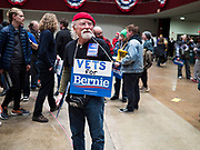 02 MARCH 2020 - ST. PAUL, MINNESOTA: BRUCE BERRY, a Bernie Sanders volunteer and US Army veteran of the Vietnam War, hands out Bernie Sanders signs at a Bernie Sanders Get Out the Vote rally in the RiverCentre in St. Paul. More than 8,400 people attended the rally. Minnesota is a Super Tuesday state this year and Minnesotans will go to the polls Tuesday. Minnesota Sen. Amy Klobuchar was expected to win her home state, but she dropped out early Monday, March 2.        PHOTO BY JACK KURTZ