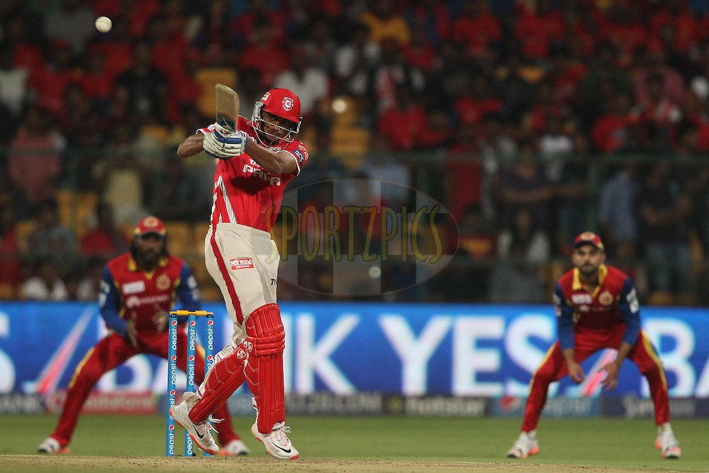 Akshar Patel of Kings XI Punjab pulls a delivery to the boundary during match 40 of the Pepsi IPL 2015 (Indian Premier League) between The Royal Challengers Bangalore and The Kings XI Punjab held at the M. Chinnaswamy Stadium in Bengaluru, India on the 6th May 2015.<br /> <br /> Photo by:  Shaun Roy / SPORTZPICS / IPL