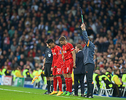 MADRID, SPAIN - Tuesday, November 4, 2014: Liverpool's substitutes Steven Gerrard and Raheem Sterling prepare to come on during the UEFA Champions League Group B match against Real Madrid at the Estadio Santiago Bernabeu. (Pic by David Rawcliffe/Propaganda)