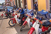 Domino pizza delivery men in Oaxaca, Mexico.