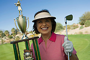 Woman Holding Golf Trophy