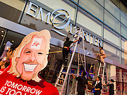 "27 MARCH 2015 - BANGKOK, THAILAND: A Richard Branson cut out figure promoting a Virgin health club in ""EmQuartier,"" a  new shopping mall in Bangkok. ""EmQuartier"" is across Sukhumvit Rd from Emporium. Both malls have the same corporate owner, The Mall Group, which reportedly spent 20Billion Thai Baht (about $600 million US) on the new mall and renovating the existing Emporium. EmQuartier and Emporium have about 450,000 square meters of retail, several hotels, numerous restaurants, movie theaters and the largest man made waterfall in Southeast Asia. EmQuartier celebrated its grand opening Friday, March 27.    PHOTO BY JACK KURTZ"