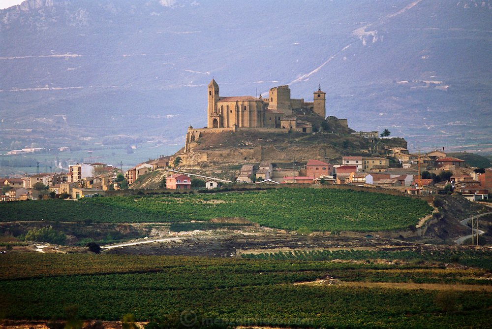Hilltop town of San Vincente de la Sonsierra dominated by its castle, before sunrise. Rioja, Spain.