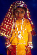 Dressed as a Rajasthani woman, child in fancy dress costume.
