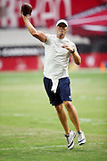 San Diego Chargers quarterback Philip Rivers (17) throws a pass while warming up before the 2015 NFL preseason football game against the Arizona Cardinals on Saturday, Aug. 22, 2015 in Glendale, Ariz. The Chargers won the game 22-19. (©Paul Anthony Spinelli)