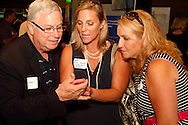 (from left) Hans Marlette of Day of Caring, Lori Klens of Market Smart Solutions and Shelagh McGovern of MONCO Secure Document Destruction during a Dayton Area Chamber of Commerce Business After Hours at the NCR Country Club in Kettering, Wednesday, July 25, 2012.  The Chamber will hold the 2012 Chamber Challenge, their 20th annual golf tournament and silent auction, at the NCR Country Club in September.