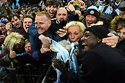 Manchester City fans get to touch the Carabao Cup during the celebrations at full time after the 3-0 win over Arsenal during the EFL Cup Final match between Arsenal and Manchester City at Wembley Stadium, London, England on 25 February 2018. Picture by Graham Hunt.