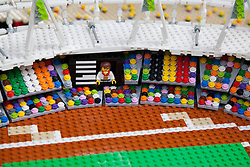 © Licensed to London News Pictures. 05/07/2012. London, UK. A minature LEGO Olympic athlete gold medal winner. LEGO creator, Warren Elsmore used around 250,000 standard LEGO bricks to create a miniature replica of the London 2012 Olympic Games Park. The model took Warren, aged 35 from Edinburgh, 300 hours to construct and is on display at the 'Visit Denmark' Olympic Village  at St Katharine Docks, London. Photo credit : Vickie Flores/LNP