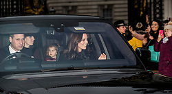 © Licensed to London News Pictures. 20/12/2017. London, UK. The Duke and Duchess of Cambridge leave Buckingham Palace with Charlotte after attending the Queen's annual Christmas lunch. Photo credit: Peter Macdiarmid/LNP