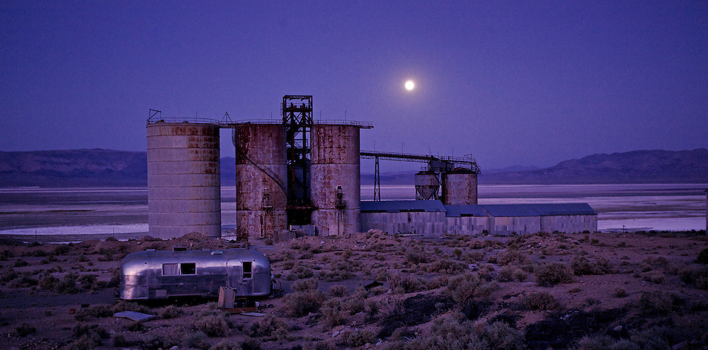 moonrise, airstream and  industrial plant