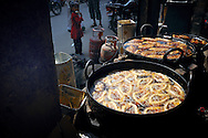 Nepal, Kathmandu. Street stall with fried snacks.